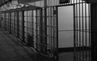 Several empty jail cells representing the role of the bail bondsmen at A-Affordable Bail Bonds in Washington State